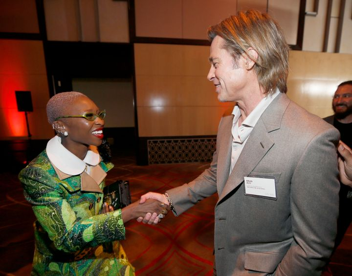 Cynthia Erivo, left, shakes hands with Brad Pitt at the 92nd Academy Awards Nominees Luncheon at the Loews Hotel on Monday, J