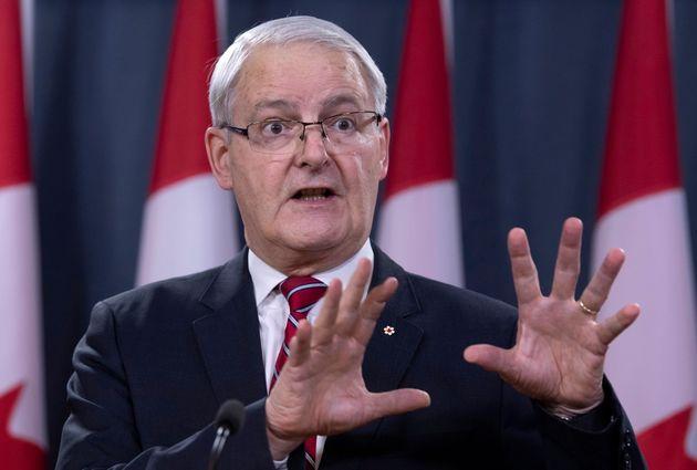 Transport Minister Marc Garneau attends a news conference in Ottawa on Jan. 15. Garneau says it's