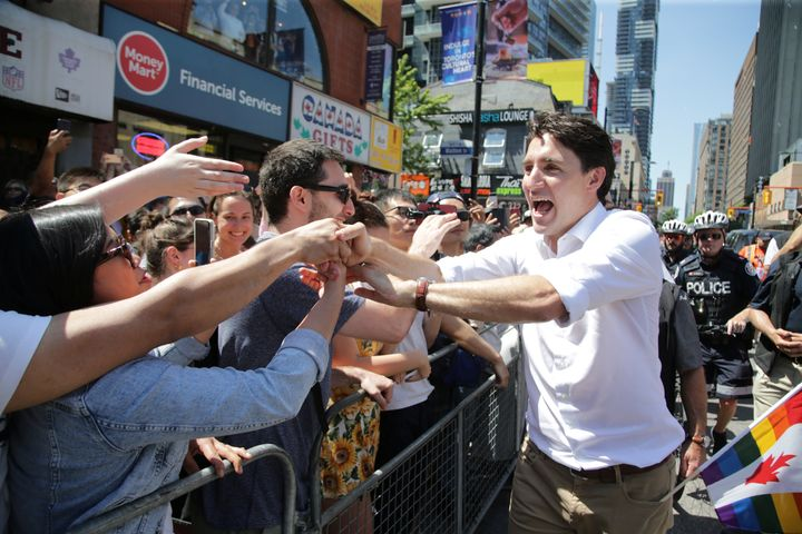 Prime Minister Justin Trudeau greets people as he joins supporters of Toronto's LGBTQ community as they march in one of North America's largest Pride parades, in Toronto on June 23, 2019.