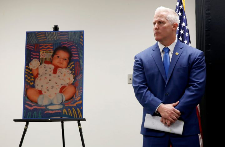 Yolo County District Attorney Jeff Reisig stands next to a photo of Kato Krow Perez, born in 2001. Kato was one of five infan