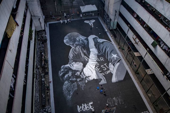 A giant mural of former NBA star Kobe Bryant and his daughter Gianna, painted hours after their death, is seen at a basketbal