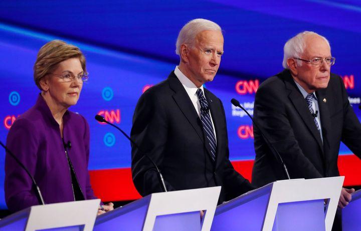 Sen. Elizabeth Warren, former Vice President Joe Biden and Sen. Bernie Sanders participate in the seventh Democratic presiden