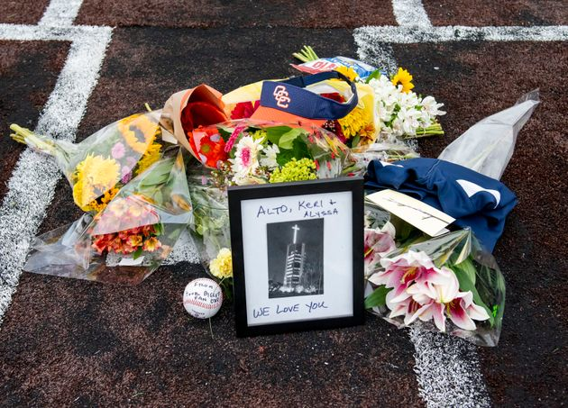 A makeshift memorial was created on home plate Orange Coast College baseball field in Costa Mesa, Calif....