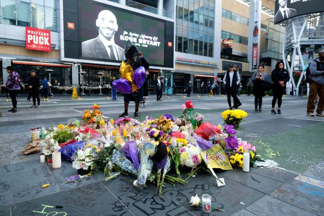 Flowers and candles are placed at a memorial for Kobe Bryant near Staples Center Monday, Jan. 27, 2020,...