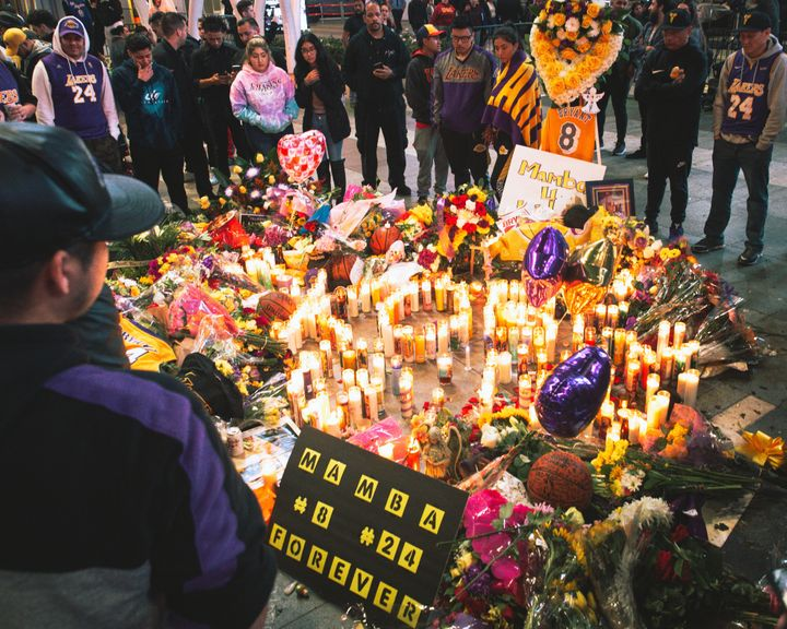Fans gather outside of the Staples Center in Los Angeles to mourn Los Angeles Lakers legend Kobe Bryant.
