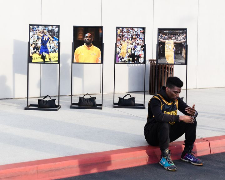 A fan sits outside of the Los Angeles Lakers training facility in El Segundo, California.