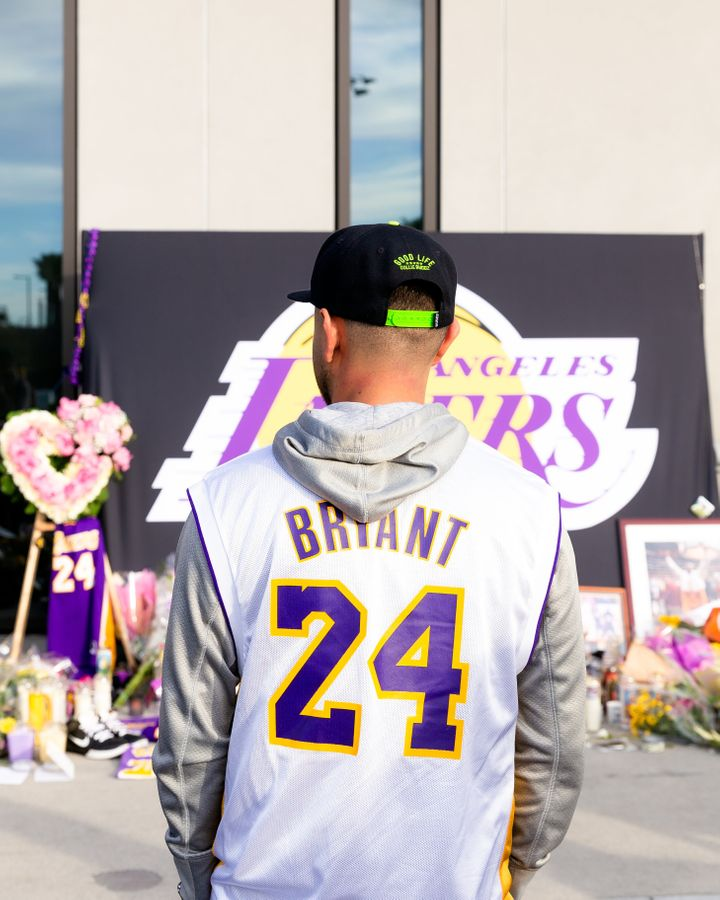 A fan wears a Kobe Bryant jersey outside of the Los Angeles Lakers training facility in El Segundo, California.