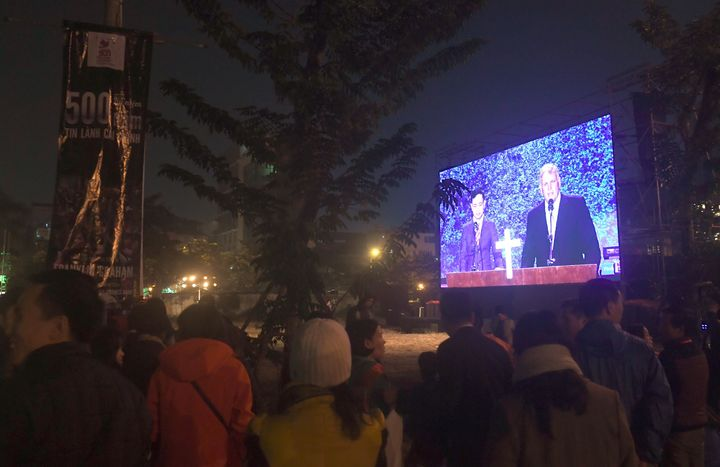 Graham addresses an evangelical event at a sports stadium in Hanoi, Vietnam, on Dec. 9, 2017.