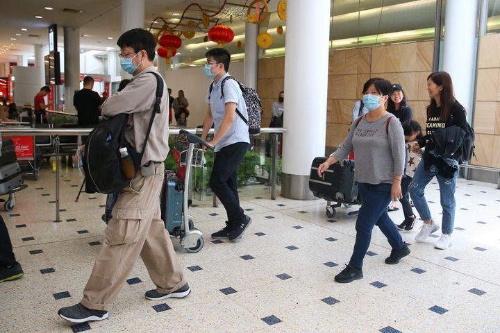 Passengers arrive at Sydney International Airport on January 23. The flight from Wuhan departed the Chinese city prior to officials temporarily closing down transportation from the city.