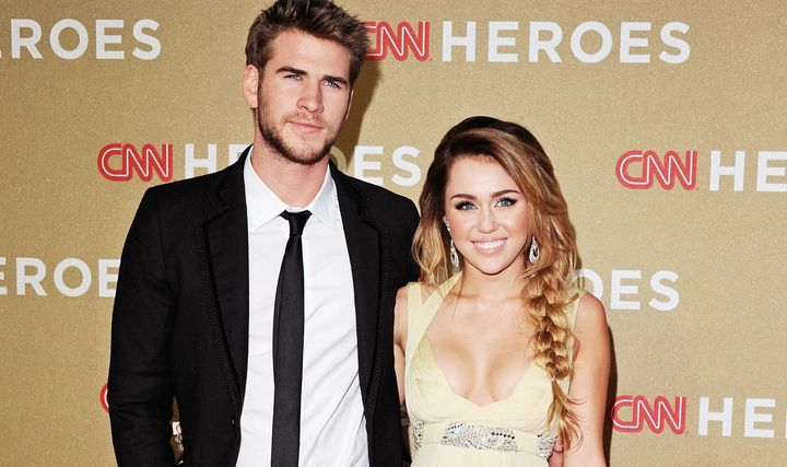 Liam and Miley at an event in 2011.
