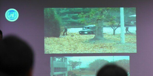 A surveillance TV footage containing the moment of defection of a North Korean Soldier, is seen during...
