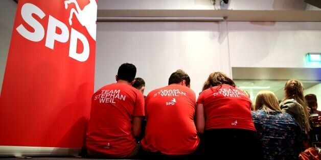 Supporters wait during the Social democratic SPD electoral party on October 15, 2017 in Hanover. / AFP...