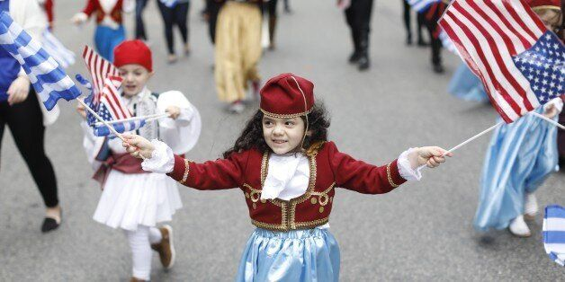 BOSTON, MA - APRIL 30: Christine Konstantilakis, 4, waves Greek and American flags during the Greek Independence...
