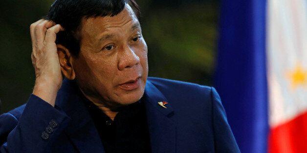 Philippine President Rodrigo Duterte speaks during a news conference at the Ninoy Aquino International...