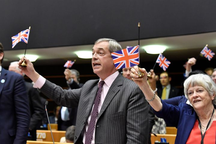 Brexit Party leader Nigel Farage holds a Union Jack aloft during a European Parliament plenary session in Brussels