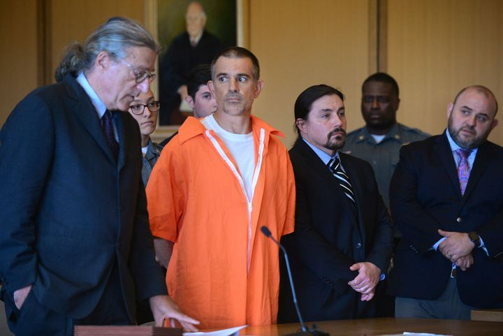 Fotis Dulos, center, listens, as his attorney Norm Pattis, left, addresses the court during a hearing at Stamford Superior Co