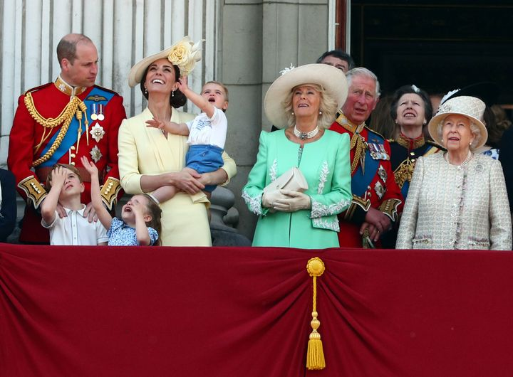 "The ""inner core"" of the Royal Family, from left to right: the Duke of Cambridge, Prince George, Princess Charlotte, the Duchess of Cambridge, Prince Louis, the Duchess of Cornwall, Prince Charles, Princess Anne, and the Queen."