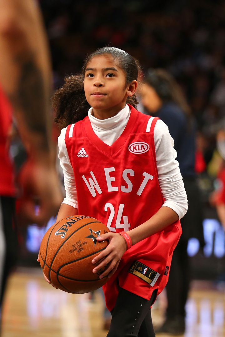 Gianna handles the ball during warmups before the game.