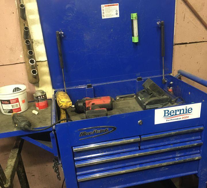 Luis Gomez promotes the candidacy of Sen. Bernie Sanders (I-Vt.) at his auto body repair shop in Des Moines.