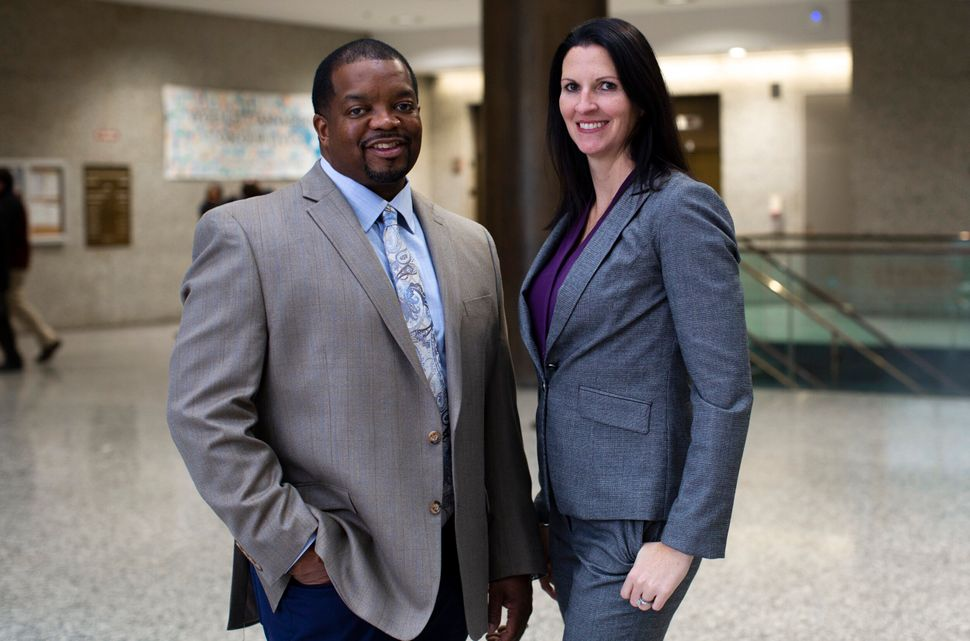 Assistant public defenders, Anthony Williams, left, and Colleen Gorman, right, pose for a portrait at the Markham courthouse on Wednesday, Jan. 22, 2020 in Markham, Illinois.