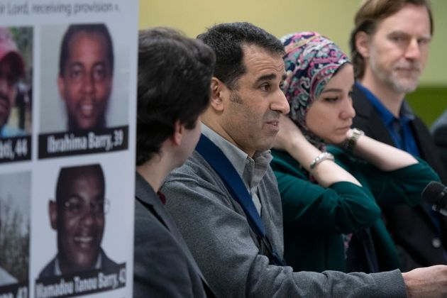 Ahmed Cheddadi, left, who was injured in the 2017 mosque shooting, speaks at a news conference marking...