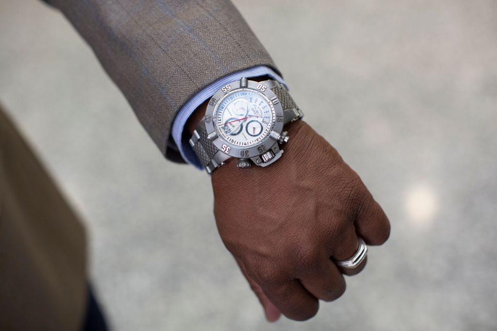 Anthony Williams shows the watch he wears in court.