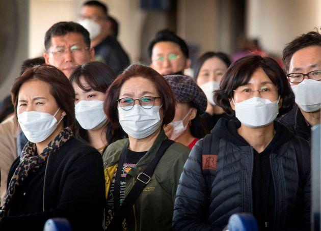 Turistas chinos con