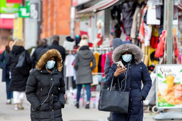 Pedestrians walk in the Chinatown district of downtown Toronto on Jan. 28,