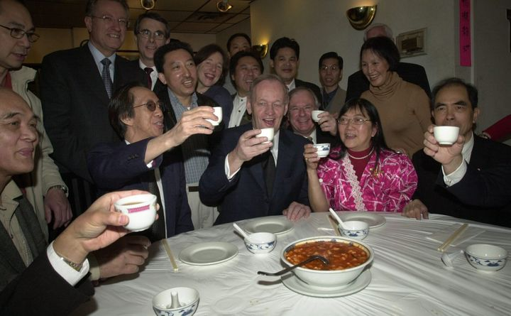 Jean Chrétien has tea with members of Toronto's Chinese community in response to SARS fears which hurt Chinese businesses, on Apr. 10, 2003.