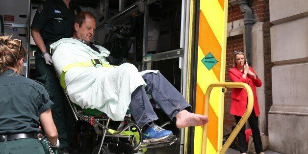 LONDON, ENGLAND - MAY 11: BBC Cameraman Giles Wooltorton is helped by Ambulance staff after reportedly...