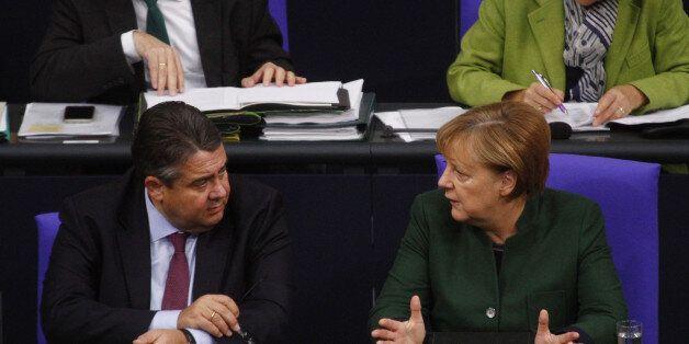 BERLIN, BERLIN - NOVEMBER 23: German Chancellor Angela Merkel (CDU) speaks with vice Chancellor Sigmar...