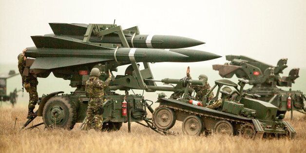 Romanian Army soldiers deploy a HAWK PIP III R ground-to-air missile launch pad during a joint military...