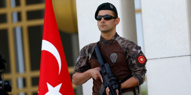A Turkish special forces police officer guards the entrance of the Presidential Palace in Ankara, Turkey,...