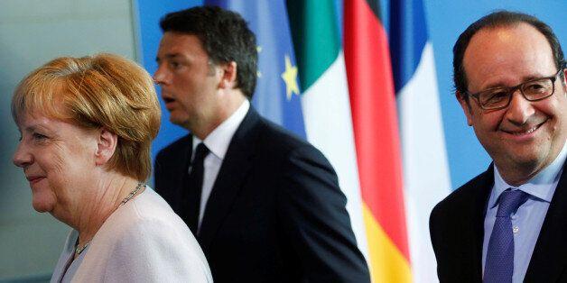 German Chancellor Angela Merkel (L), French President Francois Hollande (R) and Italian Prime Minister...