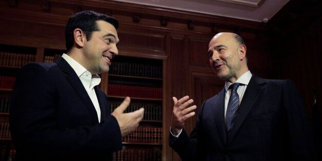 Greek Prime Minister Alexis Tsipras, left, meets with European Commissioner for Economic and Financial...