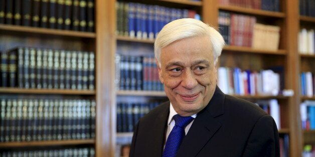 Greek President Prokopis Pavlopoulos looks on before a meeting with Popular Unity far-left leader Panagiotis...