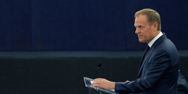 European Council President Donald Tusk addresses the European Parliament during a debate on the conclusions...