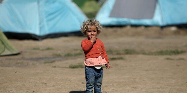 A child stands in the makeshift camp at the Greek-Macedonian border, near the Greek village of Idomeni...
