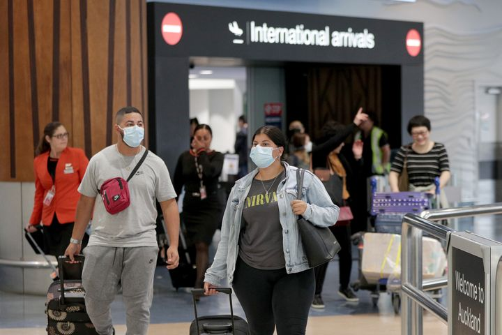 Passengers arriving on flights wear protective masks at the international airport on January 29, 2020 in Auckland, New Zealand.