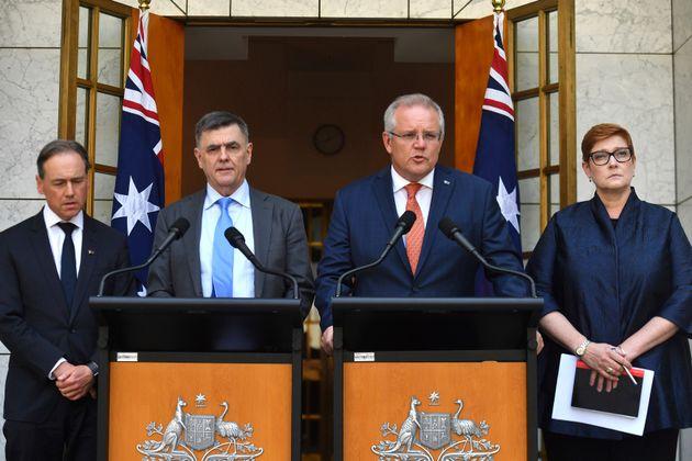 Australian Prime Minister Scott Morrison, second right, Minister for Health Greg Hunt, left, Chief Medical...