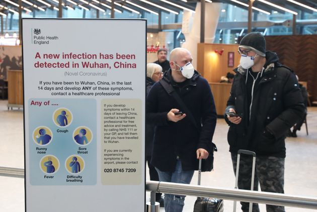 Passengers arrive at Heathrow Airport in London after the last British Airways flight from China touched...