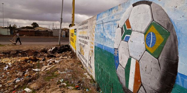 A soccer ball with different colored flags, including the South African national flag, right, painted...