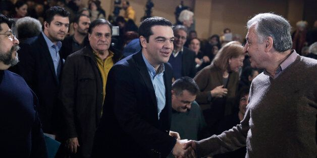 Greek Prime Minister and Syriza leader Alexis Tsipras, centre, arrives at his party central committee,...