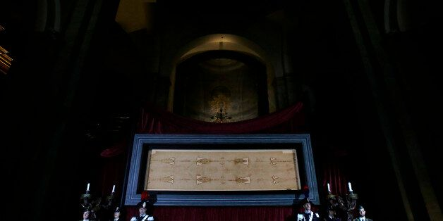The Holy Shroud, the 14 foot-long linen revered by some as the burial cloth of Jesus, is on display at...