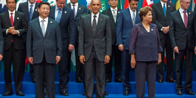 U.S. President Barack Obama, center, with other world leaders gather during the G20 Summit family photo...