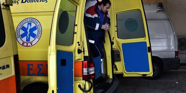 TO GO WITH AFP STORY BY SOPHIE MAKRISA paramedic exits an ambulance outside a hospital on the eastern...