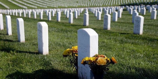 Flowers are placed over a war veteran's tombstone at Golden Gate National Cemetery on Monday, Nov. 10,...