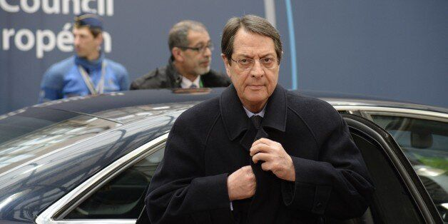 President of Cyprus Nicos Anastasiades arrives for a European Union summit in Brussels on March 20, 2015....