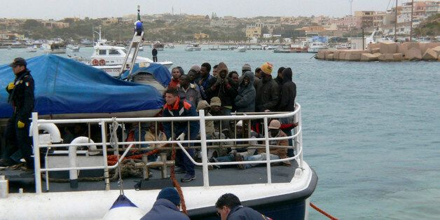 An Italian Coast Guard boat carrying some would-be immigrants, rescued at sea, reaches the port of the...