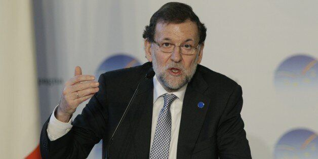 Spain's Premier mariano Rajoi talks talks to journalists during a press conference, at the end of a bilateral...